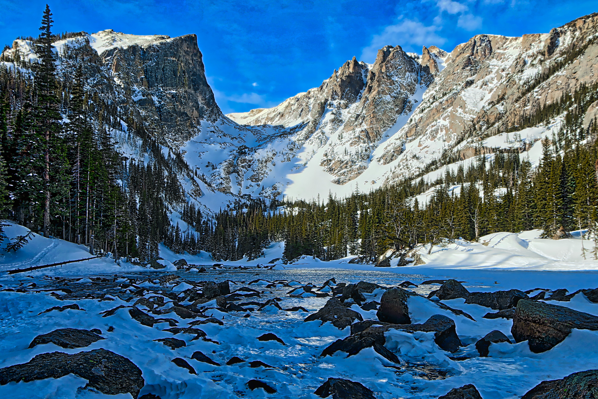 In a stark winter landscape, Hallett Peak rises into the blue sky. On a snowshoeing trip to Emerald Lake, I stopped at Dream Lake to snap a few shots. It was a rare moment, in one of the most popular snowshoeing locations in Rocky Mountain National Park, to get a picture like this, without any people.