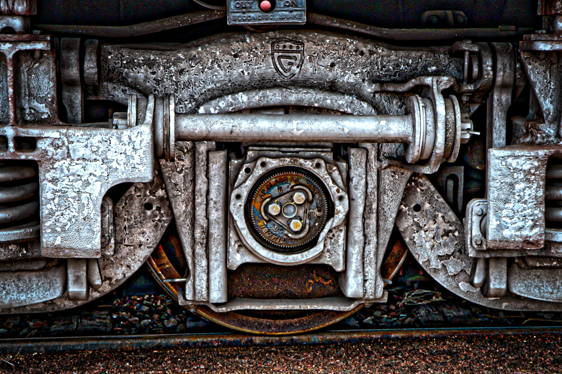 "Preparing for a trip on the Royal Gorge Railroad, I realized how interesting the train wheels well. The years had worn the metal, but it still had the strength to take us where we needed to go. The rust seemed to be just right, as if to say, ""I've earned the right to travel these tracks."""
